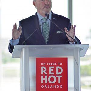 Orlando Mayor, Buddy Dyer speaking at the podeum
